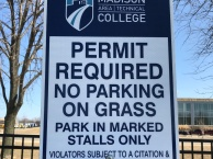 Parking sign outside of Truax Campus