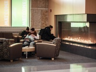 students by fireplace in gateway