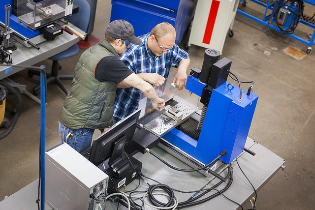 Students working on machine in Madison College's Manufacturing Lab
