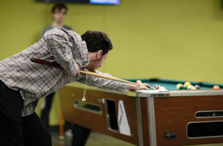 students playing pool in the Den